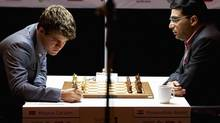Magnus Carlsen is a a 22-year old phenomenon who models in his spare time while Viswanathan Anand is a superstar in his home country of India. (Kent Skibstad/ASSOCIATED PRESS)