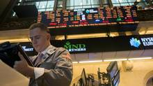 A trader works on the floor of the New York Stock Exchange in New York July 20, 2012. (KEITH BEDFORD/REUTERS)