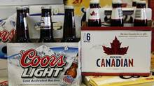File photo of Coors Light and Moson Canadian on sale in Denver, Colo. (Ed Andrieski/AP)