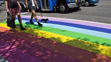 Local residents cross a rainbow painted crosswalk in Vancouver, British Columbia July 29, 2013. The crosswalks were painted to celebrate Vancouver Gay Pride Week and will be left permanently to mark the heart of the city's gay community. (ANDY CLARK/REUTERS)