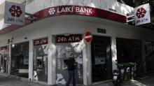 A restructuring will jeopardize the retirement savings that Laiki employees have built up over their careers, making them arguably the biggest losers of all in Cyprus's unfolding disaster. (YORGOS KARAHALIS/REUTERS)