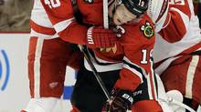 Chicago Blackhawks captain Jonathan Toews, right, battles for position in front of the goal with Detroit Red Wings counterpart Henrik Zetterberg during their Western Conference semi-final series. (Nam Y. Huh/The ASSociated Press)