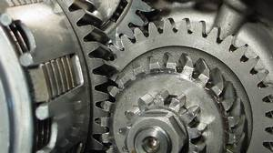 A close up of cogs in an engine.