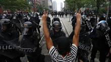 A protester confronts a police line at a protest during the G20 summit in downtown Toronto on June 26, 2010. (MIKE SEGAR/REUTERS)