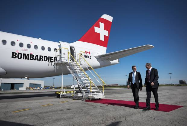 Fred Cromer, left, president of Bombardier Commercial Aircraft, and Rob Dewar, vice-president of the C Series Aircraft Program, walk past the new CS100 aircraft at a 2015 Toronto event.