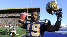 Winnipeg Blue Bombers' running back Chris Garrett celebrates after defeating the Hamilton Tiger-Cats during their CFL Eastern final football game in Winnipeg, Nov. 20, 2011. (TODD KOROL/REUTERS)