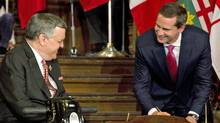 Ontario Premier Dalton McGuinty shares a laugh with Lieutenant-Governor David Onley as he swears in his cabinet at Queen's Park in Toronto on Oct. 20, 2011. (Frank Gunn/THE CANADIAN PRESS)