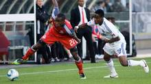 Toronto FC's Tony Tchani, left, is chased by Vancouver Whitecap's Gershon Koffie during first half game 1 Nutrilite Canadian Championship finals soccer action in Vancouver, B.C., on Wednesday May 18, 2011. (GEOFF HOWE)