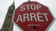 A government stop sign is seen near the Peace Tower in Ottawa on Wednesday, Dec. 30, 2009. (Sean Kilpatrick)