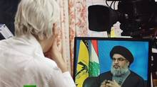 "Wikileaks founder Julian Assange interviews Hezbollah's leader Sayyed Hassan Nasrallah during his new ""The World Tomorrow"" talk show, in this frame taken from handout footage provided by Russia Today April 17, 2012. (HANDOUT/REUTERS)"