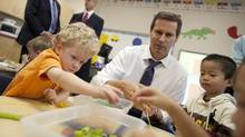 Ontario Premier Dalton McGuinty builds necklaces with Nathan Skinner, 3, left, and Alex You, 4, in a full-day kindergarten class at Stoney Creek Public School in London on Oct.8, 2010. (GEOFF ROBINS FOR THE GLOBE AND MAIL/GEOFF ROBINS FOR THE GLOBE AND MAIL)