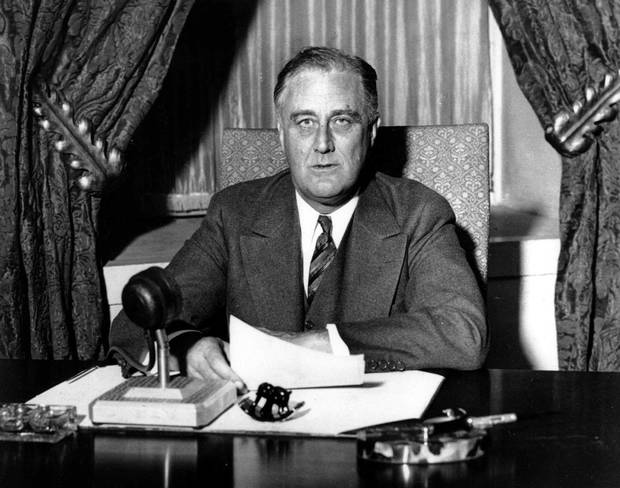 President Franklin D. Roosevelt prepares to begin his first fireside chat to the American people in this March 12, 1933 file photo.