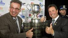 Shawinigan Cataractes president Real Breton, left, and Shawinigan Mayor Michel Angers pose with the trophy after winning the bid to hold the 2012 Memorial Cup. (Ryan Remiorz/The Canadian Press)