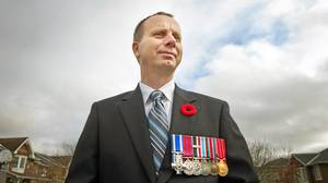 Veteran Tom Hoppe is seen outside of his home in Kingston, Ontario on November 6, 2010.