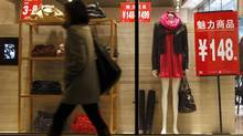 A Beijing shop window displays goods that a budding middle class seeks in China's growing economy. (DAVID GRAY/REUTERS)