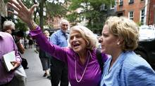 Edith Windsor, middle, reacts to cheers as she arrives for a news conference following the U.S. Supreme Court 5-4 ruling striking down as unconstitutional the Defense of Marriage Act, in New York June 26, 2013. At right is Windsor's lawyer Roberta Kaplan. The Court ruled in favor of Windsor, who sued the federal governement for failing to recognize her marriage to her partner Thea Spyer after Spyer's death. (MIKE SEGAR/REUTERS)