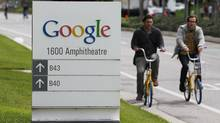 Google workers ride bikes outside of Google headquarters in Mountain View, Calif., Thursday, April 12, 2012. (Paul Sakuma/AP)