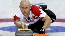 Canada's Ryan Fry delivers the rock during the men's curling match against the United States at the 2014 Winter Olympics, Sunday, Feb. 16, 2014, in Sochi, Russia. (AP)