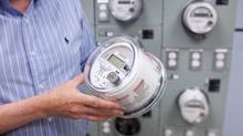 Gary Murphy, chief project officer for smart metering at BC Hydro, holds a smart meter unit on July 5, 2011. (Brett Beadle for The Globe and Mail)