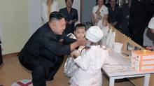 North Korean leader Kim Jong-un visits Kyongsang Kindergarten in this undated picture released by the North's KCNA in Pyongyang July 15, 2012. (KCNA/REUTERS)
