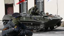 A Russian flag is seen on top of an armoured personnel carrier in Slaviansk April 16, 2014. At least three armoured personal carriers that were driven in to the eastern Ukrainian city of Slaviansk had been under the control of Ukrainian armed forces earlier on Wednesday, Reuters photographers said. (GLEB GARANICH/REUTERS)