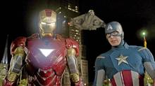 "Iron Man, portrayed by Robert Downey Jr., left, and Captain America, portrayed by Chris Evans, in a scene from ""The Avengers"" (AP)"