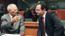 German Finance Minister Wolfgang Schauble (L) with Greek counterpart George Papaconstantinou (R) during an extraordinary euro zone finance ministers meeting at the EU Council in Brussels June 14, 2011, to discuss Greece's fiscal adjustment program. (THIERRY ROGE/REUTERS)