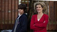 Dylan Roberts, left, who attends the French highschool Monseigneur de Charbonnel, poses for a photo with his mother Lynda Rinkenbach, right, at their Toronto home on Friday, October 19, 2012. (Michelle Siu/The Canadian Press)