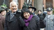 New Democratic Leader Jack Layton and his wife, fellow MP Olivia Chow, campaign in Toronto on the Easter long weekend. (Jacques Boissinot/The Canadian Press)
