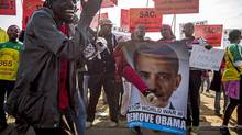 Protesters holding anti-Obama banners chant and dance together outside the University of Johannesburg campus in the Soweto area of Johannesburg, South Africa, June 29, 2013. Obama was speaking at a town hall for young African leaders at the university as part of his three-nation tour of Africa this week. (BRYAN DENTON/NYT)