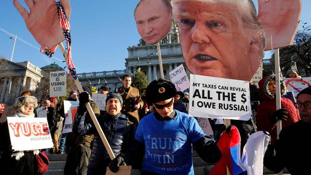 People protest against U.S. President-elect Donald Trump as electors gather to cast their votes for U.S. president at the Pennsylvania State Capitol in Harrisburg, Pennsylvania, U.S. December 19, 2016.