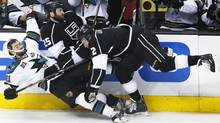 San Jose Sharks left wing T.J. Galiardi (21) collides with Los Angeles Kings left wing Dustin Penner (25) and defenseman Matt Greene (2) in the first period during Game 7 of their Western Conference semi-final hockey playoff in Los Angeles, California May 28, 2013 (Reuters)