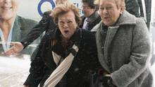 Parti Québécois Leader Pauline Marois, right, arrives with women's rights activist Janette Bertrand during a Quebec provincial election campaign stop in Laval, Que., on March 30, 2014. (GRAHAM HUGHES/THE CANADIAN PRESS)