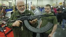 Retired policeman Ken Halterman, holds an AK-47 with a 75-round clip during the Rocky Mountain Gun Show Sunday, March 3, 2013, in Sandy, Utah. (Rick Bowmer/The Associated Press)