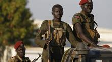 SPLA soldiers stand in a vehicle in Juba, the South Sudanese capital, on Dec. 20, 2013. (GORAN TOMASEVIC/REUTERS)