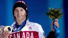 Canadian Mark McMorris receives his bronze medal for snowboard slopestyle at the medal ceremonies during the 2014 Sochi Winter Olympics in Sochi, Russia on Feb. 8. (Nathan Denette/Canadian Press)