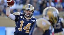 Winnipeg Blue Bombers quarterback Joey Elliot makes a pass against the Hamilton Tiger-Cats during the first half of their CFL game in Winnipeg, August 16, 2012. (FRED GREENSLADE/REUTERS)