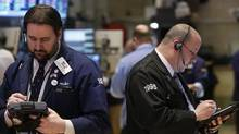 Traders work on the floor at the New York Stock Exchange (BRENDAN MCDERMID/REUTERS)