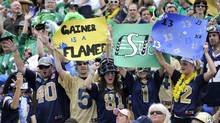 Winnipeg Blue Bomber fans cheer on their team during the annual Canadian Football League Labour Day game against the Saskatchewan Roughriders in Regina. (FRED GREENSLADE/Fred Greenslad/Reuters)