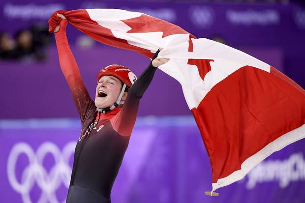 Feb. 17, 2018: Canada's Kim Boutin, of Sherbrooke, Que., celebrates after winning bronze in the women's 1500-metre short-track speedskating at the 2018 Olympic Winter Games.