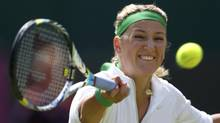 Belarus' Victoria Azarenka returns to Romania's Irina-Camelia Begu in their women's singles tennis match at the All England Lawn Tennis Club during the London 2012 Olympics Games on Monday. (STEFAN WERMUTH/REUTERS)