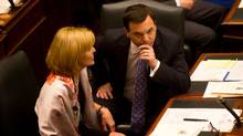 Opposition leader Tim Hudak and MPP Christine Elliott reacts during the Speech from the Throne at Queen's Park in Toronto, Ont. Tuesday, February 19, 2013. (Kevin Van Paassen/The Globe and Mail)