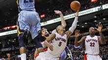 Toronto Raptors' guard Jerryd Bayless goes to the basket against Memphis Grizzlies' Marc Gasol and Rudy Gay during the Grizzlies' 100-98 win in Toronto on Jan. 24, 2011. (MARK BLINCH/Mark Blinch/Reuters)