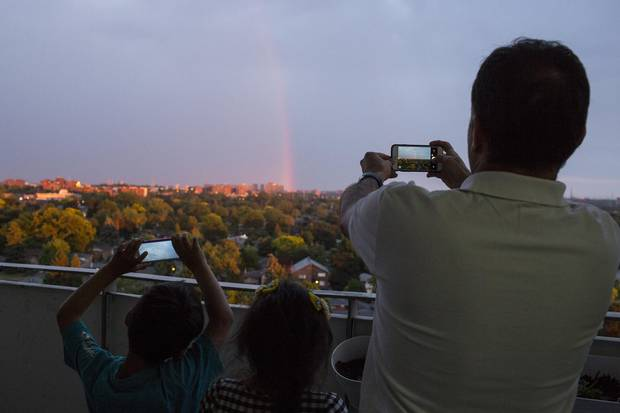 An omen? During the special meal prepared to break their Ramadan fast, the family suddenly spots a rainbow from their balcony.