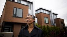 Monique Choptuik is photographed outside her rowhouse (left) in Vancouver, British Columbia, Thursday, June 7, 2012. (Rafal Gerszak/The Globe and Mail)