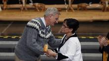 Sweden's Foreign Minister Carl Bildt hands the gavel which symbolizes handing the chairmanship of the Arctic Council to Canada's Minister of the Arctic Council Leona Aglukkaq, at the Arctic Council Ministerial Meeting, in Kiruna, Sweden, Wednesday, May 15, 2013. (Charles Dharapak/AP)
