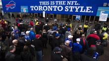 Fans enter the Rogers Centre before the Buffalo Bills play the Atlanta Falcons in NFL action in Toronto, Sunday December 1, 2013. (Mark Blinch/THE CANADIAN PRESS)