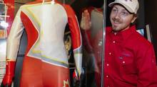 Canadian alpine skier John Kucera looks over the team's Sochi Olympcs ski suit at a new exhibit at Canada's Sports Hall of Fame in Calgary, Alta., Friday, Nov. 22, 2013. (JEFF MCINTOSH/THE CANADIAN PRESS)