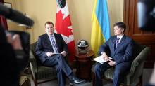 Canadian Foreign Affairs Minister John Baird (left) meets with Vadym Prystaiko, Ukrainian Ambassador to Canada, on Parliament Hill in Ottawa, Tuesday, March 4 2014. (FRED CHARTRAND/THE CANADIAN PRESS)