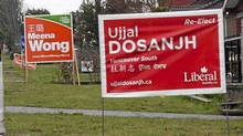 Signs for the NDP candidate for Vancouver South Meena Wong are seen alongside signs for Liberal rival Ujjal Dosanjh. Vancouver, April 24, 2011. (Brett Beadle for The Globe and Mail/Brett Beadle for The Globe and Mail)